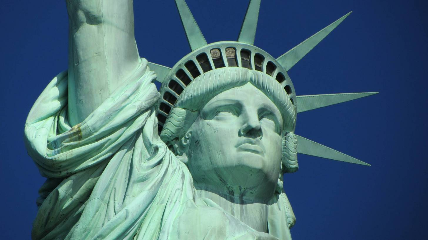 statue of liberty welcoming visitors to the US