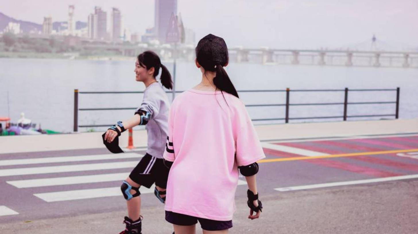 two young girls roller blading