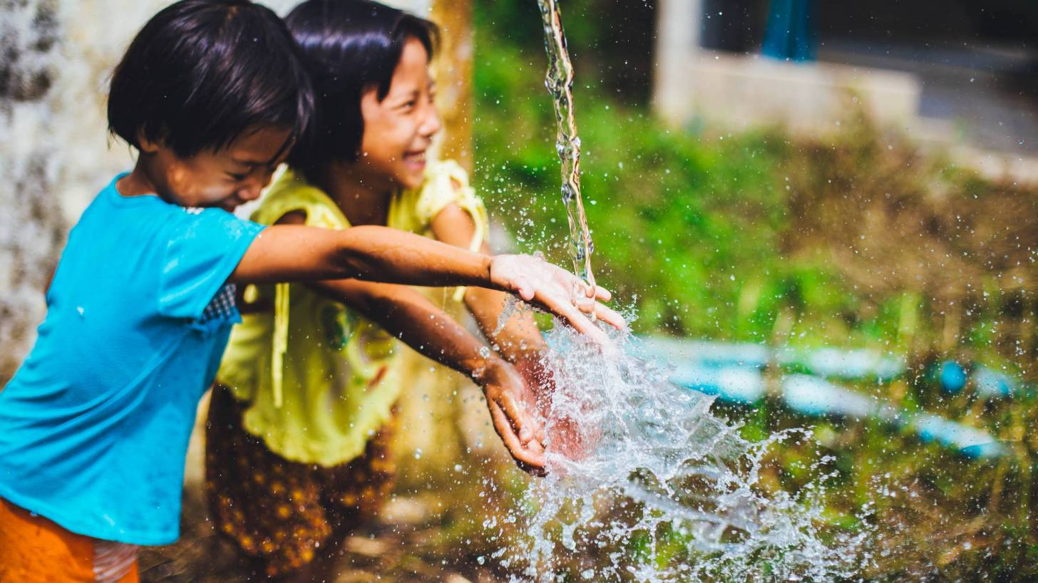 children playing in the water fountain