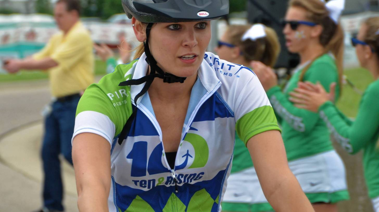 woman riding a bike in a charity event