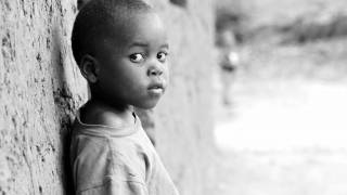 young african boy looknig at the camera