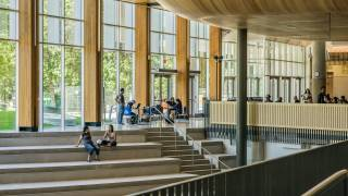 College students studying in open library
