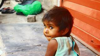 young cute child in the street of India