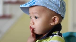 asian boy blowing a kiss