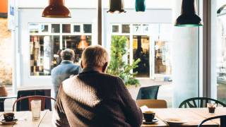 older men sitting in a cafe