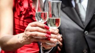 couple celebrating with champagne flutes