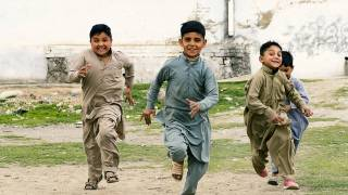 children running, laughing