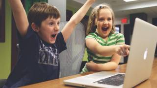 children celebrating on their computer