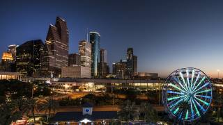 houston skyline with ferris wheel at night
