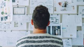 man looking an idea board