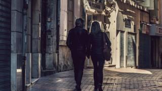older couple walking thru an old town in europe