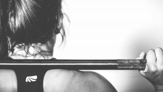 strong woman lifting weights keeping healthy