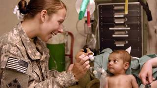 army doctor taking care of an infant patient