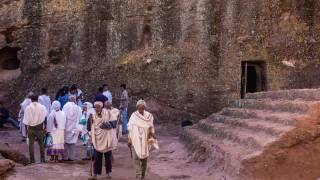 ethiopians outside an ancient building