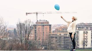 pregnant woman holding a balloon