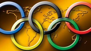 olympic rings on golden map