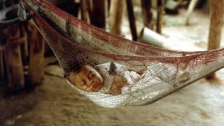 baby sleeping in a hammock netting