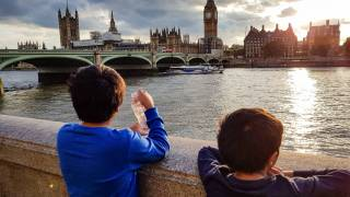 two young children looking at the city of london