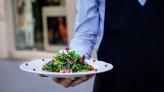 waiter serving a salad