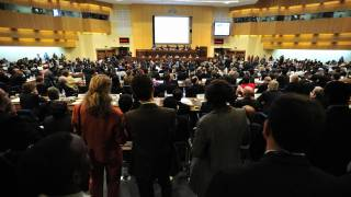 un meeting to discuss ebola. large meeting hall filled with people