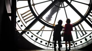 women looking at a clock