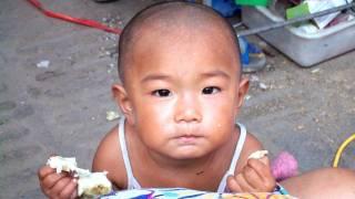 young chinese girl looking at camera