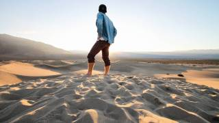 man standing in the desert by himself contemplating life