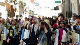 Japan tourists taking photos of G20 event
