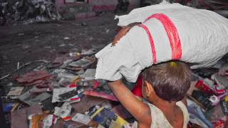 young child working in the slums