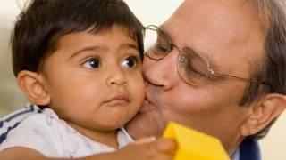 Grandpa kissing grandson