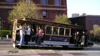 SF cable car people riding