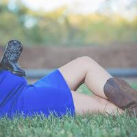 pregnant gal with cowboy boots on in Texas