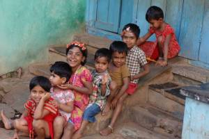 Indian children sitting on steps, happy