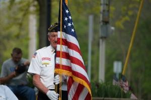 honor guard older vet with flag