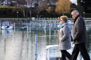 older couple walking near the marina