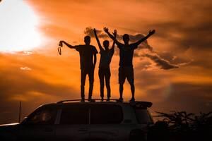 men celebrating on top of ridge