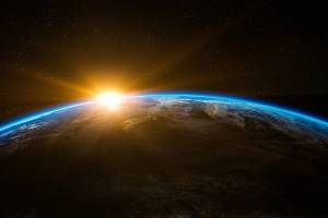 sun rising over the earth taken from the space station