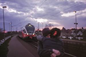 couple in love train coming