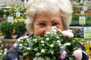 senior woman looking at flowers