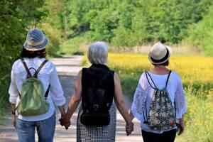 women holding hands looking hopeful