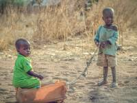 young children in africa playing with a box