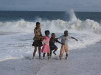 happy children splashing in the ocean