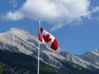 canadian flag over the mountains