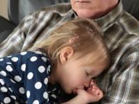 grandpa holding his grandchild