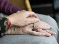 care giving holding PD patient hands