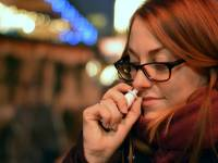 woman taking a nasal spary for the flu