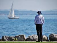 old man looking at the lake