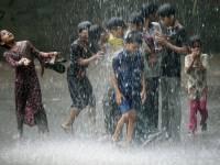 children playing in the rain